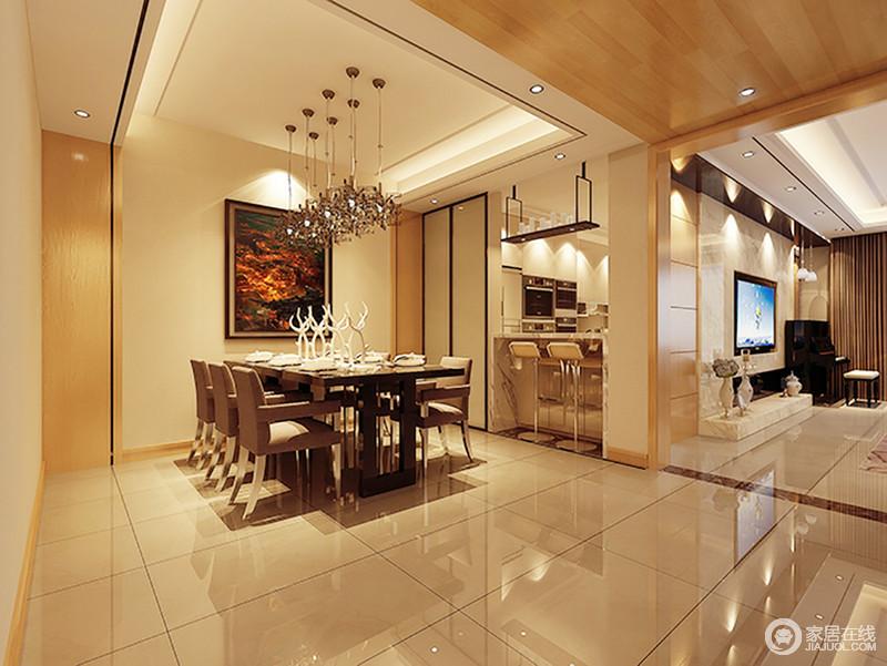 餐厅墙面造型与顶面造型相连,拉伸整个空间的结构,凸显几何之美;以米色地砖和米色漆粉刷空间,搭配暖黄色光,渲染了一份和暖;火焰风景画和水晶吊灯,装饰着现代家具,让用餐也成为一种惬意和仪式。