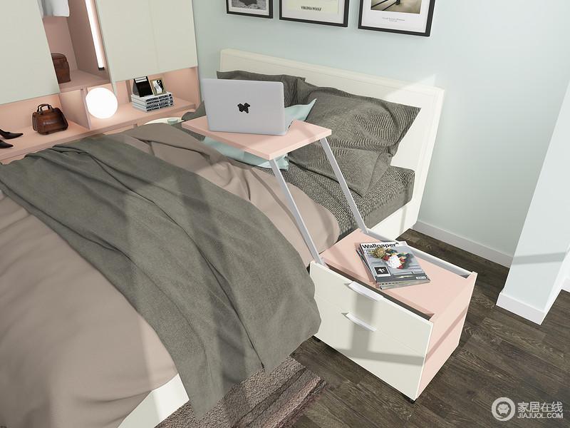 在床边设置升降床头柜,不仅可以收纳物品,又具备餐桌及书桌的功能。