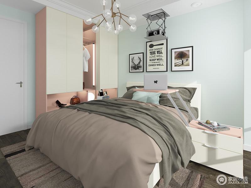 墙面淡淡的蓝色免去了白墙的单调,粉色柜身和白色柜门的搭配让空间多了分清新感,,投影仪巧妙的隐藏在了屋顶上,既不占用空间,也不影响整体美观。
