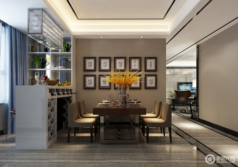 餐桌椅朴质厚重的搭配出端正沉稳气质,大束明媚花艺与照片墙辉映,渲染出浪漫艺术氛围的就餐环境,连带着休闲吧台的意蕴也悠然惬意;一体式吧台,设计了多功能置物架,让空间休闲且实用。