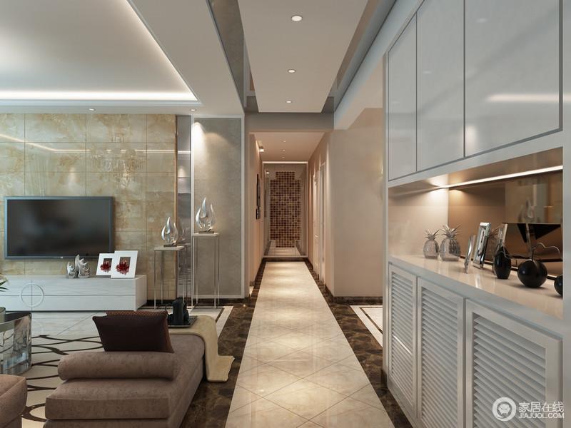 空间利用建筑结构来做一种开放式的区分,走廊以米色与褐色的砖石做强化,同时,借吊顶延伸出一种线条的简单;白色定制实木柜解决了收纳上的困惑,与马赛克墙面构成和谐,张扬实用与美观并存的艺术。