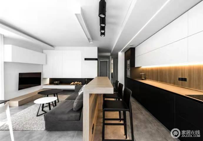 客厅做了个小吧台设计,巧妙地解决了空间的区域性问题,让开放式的空间内具有了结构感;吧台的原木与黑白色调的橱柜构成抽象艺术,更有质感。