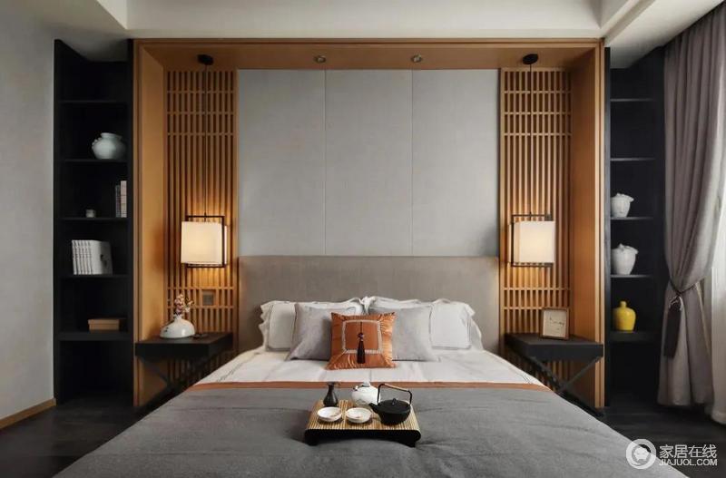 床头屏风两侧以木色隔板来造就中式的空灵,矩形吊灯的新中式味道,让家多了新韵,黑色床头柜摆上主人收藏的书籍与陶艺品,也让卧室更加更加端庄而高级雅致。