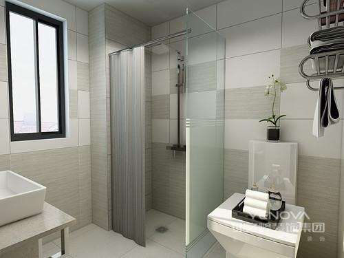 墙面用两种颜色的墙砖拼色,一股浓浓的艺术范,简单白色的洁具早整体灰色空间内显得更加突出。
