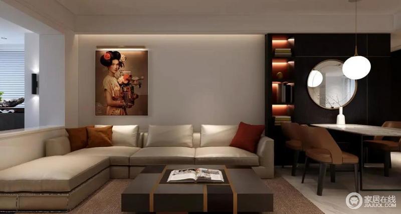 乳白色的L形沙发看起来或许平平无奇,一旦配上故宫红的抱枕,和一副女性挂画,立刻让空间鲜亮起来,搭配中方形深棕色茶几不仅保证储物,也十分具有设计感。