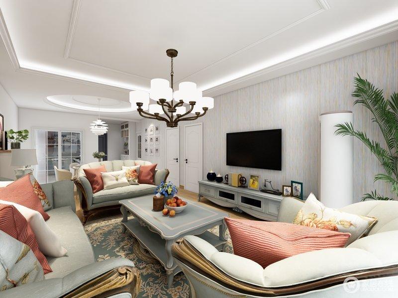 客厅采用现代欧式相结合的设计、墙面背景采用的明度不高的白色,既不刺眼也不会很黑暗,反而给人一种通透明亮的感觉,灯具使用的是简约的欧式灯具,黑白明显,视觉感较强,沙发茶几柜子则采用的是较深一点的灰色,和墙面背景形成对应,沙发上添加一点红色黄色的枕头作为点缀,起到了画龙点睛的作用。