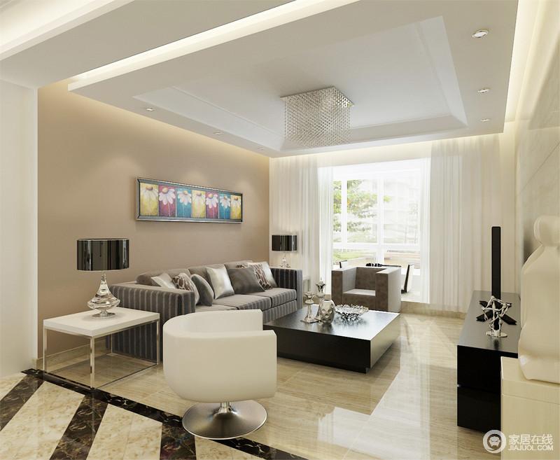 客厅以块状感的设计来表现空间的规整,驼色漆粉刷的背景墙与米色砖石,造就了空间温和的气氛;灰色条纹沙发质感上乘,搭配黑白色的茶几、边几和半圆椅,陈列出现代庄重和经典大气。