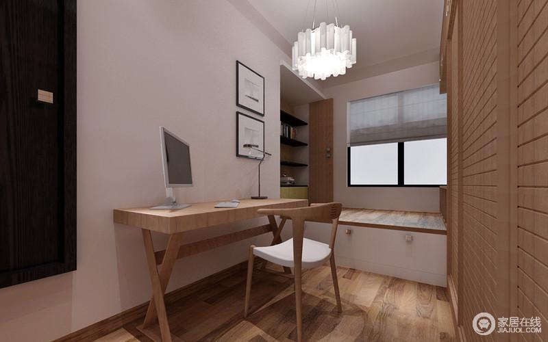 空间遵循少即是多的原则,不但采用了榻榻米,通过通顶衣柜与壁龛,打造小户型多收纳功能,并将一切收纳于无形。简约的木质书台与镂空靠椅,演绎极简主义。