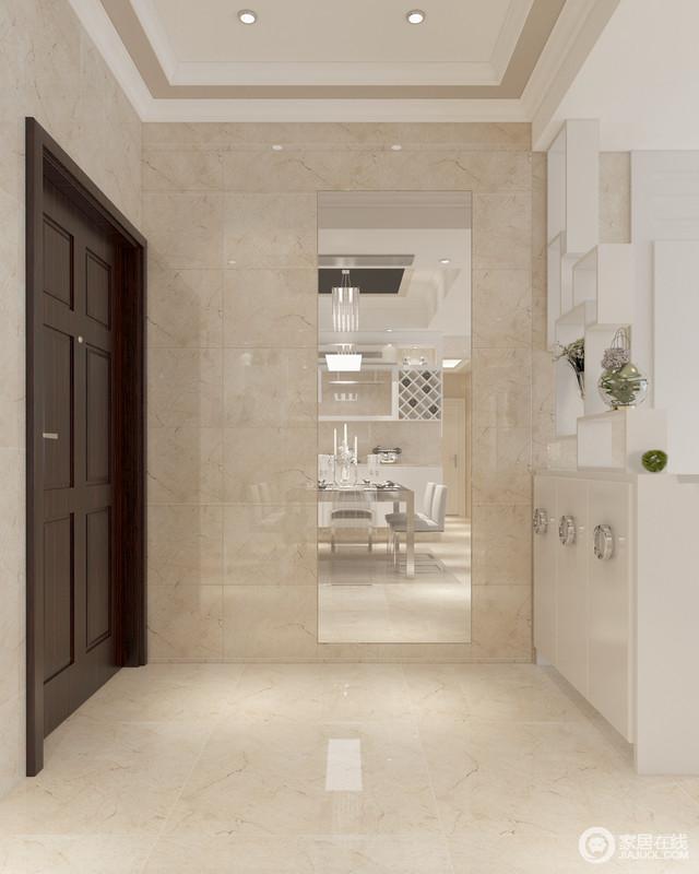 玄关区统一的砖石铺贴出一个视觉感柔和的空间,白色收纳柜上镶嵌的圆形金属兼具装饰和实用双重功效;方体几何置物架简易质朴,雕琢着简单。