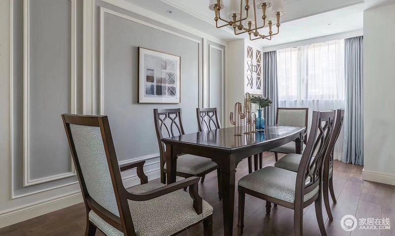 餐厅延续了客厅的风格,素简的实木餐桌椅与地板材质相同,在立体墙面的衬托下,突显出几分美式的休闲;靠窗区域,巧妙的规划着酒柜,使空间舒朗实用。