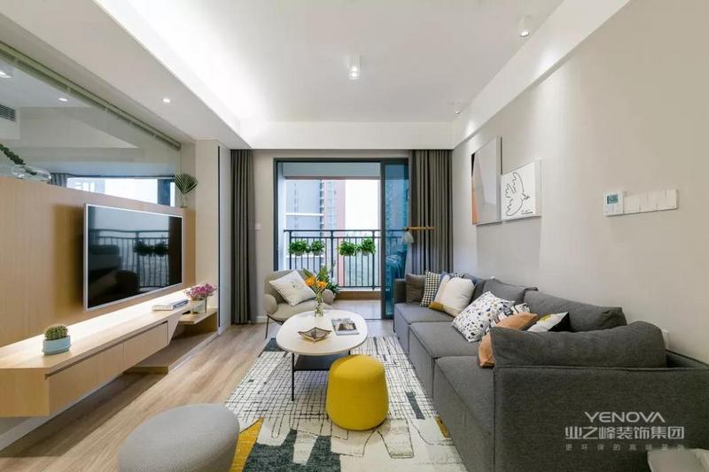 客厅硬装简洁大气,在装饰画的点缀下,营造出一个温馨舒适的休闲空间。浅灰色背景墙与沙发相呼应,空间整体统一。