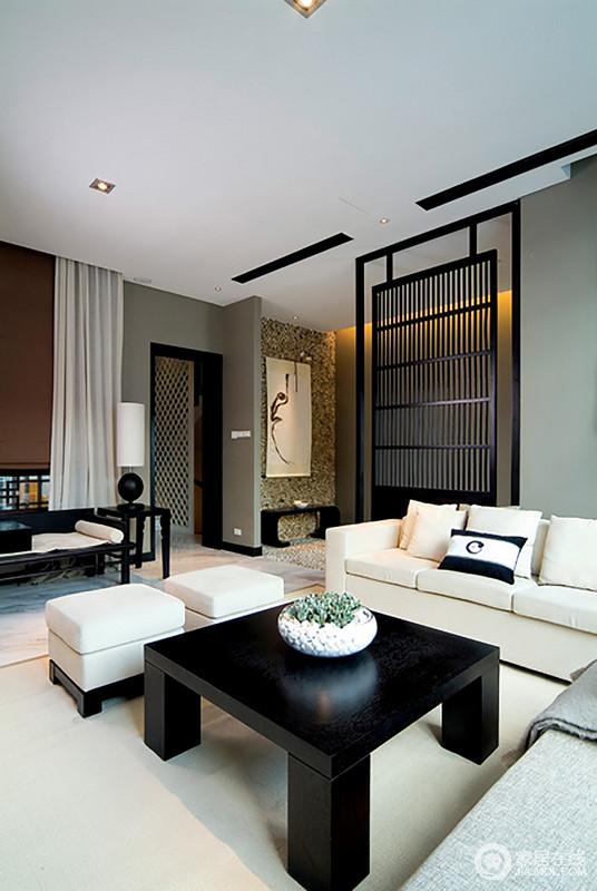 客厅色彩以灰色漆粉刷墙面,与米白色沙发、黑檀木茶几、边几等,形成经典支配,庄重而具有层次美学;木楞隔断简单划分了空间至于,让整个空间具有结构美学,并与新中式家具组合出了新东方意境,简洁儒雅。
