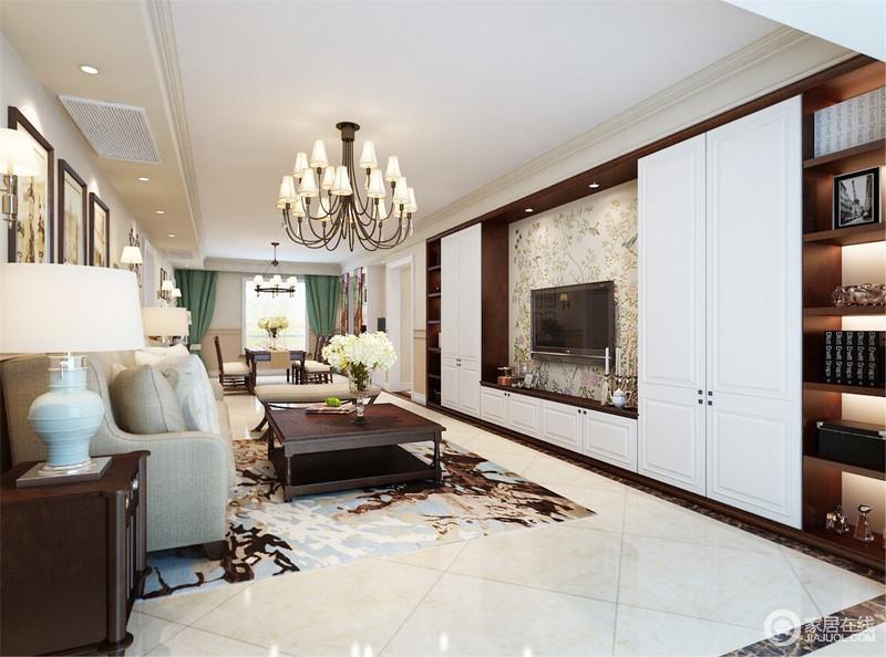 空间结构简洁,线条利落,曲线感的金属吊灯让空间灯光辉煌;电视背景墙定制得白色储物柜与书柜组合出了规整和实用美学,简单之中裹挟着淡淡地文艺气息。