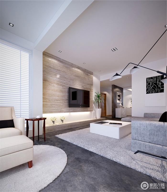 客厅的挑高给人无限的空间感,利用结构将会客区与阳台休闲区做了简单的区分,而深灰色地面上的中性色几何毯以不同的形质,装饰出了现代简洁;浅灰色的布艺沙发搭配白色茶几、黑色落地灯组合出了黑白时尚,而米色美式扶手椅带来些许消闲,却表达着生活的温实和简美。