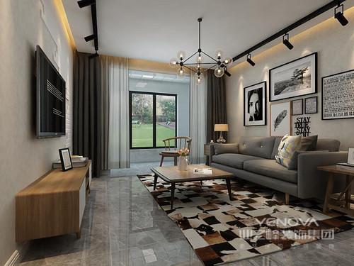 客厅以白色墙面与灰砖构成空间层次,玻璃球泡吊灯和射灯以不同的功能实现功能照明和情景渲染,让每一幅挂画都有了光影的魅力,同时,让空间也多了光的温度;灰色布艺沙发搭配拼色地毯,无形中构成冷暖交织,愈发凸显实木桌几带来的北欧温实。