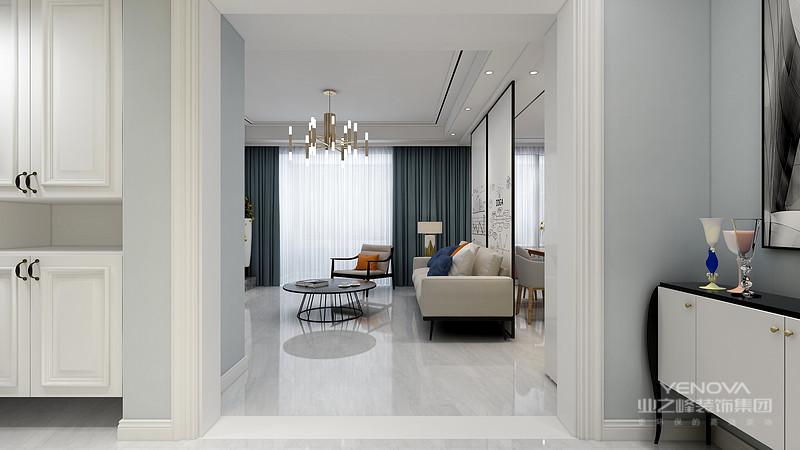 客厅灰白为空间营造了一份淡淡地清新,白色布艺沙发虽然有些单调,但是彩色挂画为空间增添了不少自然风情,满是清和。