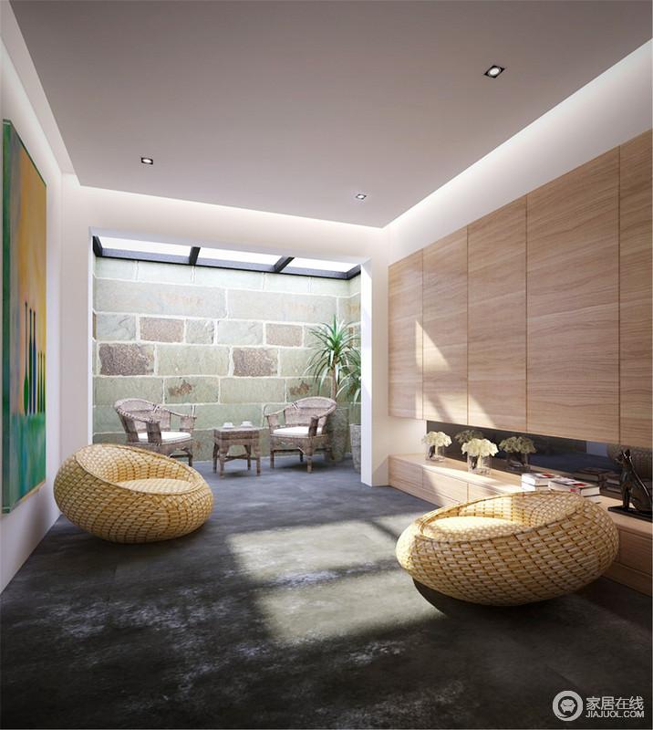 休闲室的吊灯因为灯带的装饰更为精致了不少,木柜组合解决实用之需,也为略显灰静的空间带来些许温度,与黄色圆墩沙发、彩色油画,营造着艺术感和生活的质感;青色砖的几何立面与户外家具组合成就着生活的惬意,简单地成就了安适。