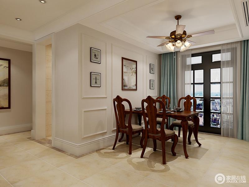 餐厅以乳白色石膏成就墙面的几何效果,素色的挂画对称出和谐与大气,蓝色窗帘巧妙点缀出优雅;美式胡桃木餐桌椅的复古设计,格外具有美式尊贵。