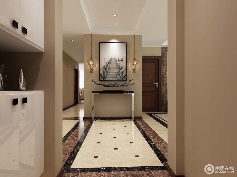 门厅以驼色漆粉刷空间,奠定了空间的稳重,而白色鞋柜的设计实现了储物,让收纳更为利落;地砖以不同颜色的砖石铺贴出了几何造型,与现代金属岸几和黑白画作构成精致,造型别致地木吊灯装饰出生活的温情与暖意。