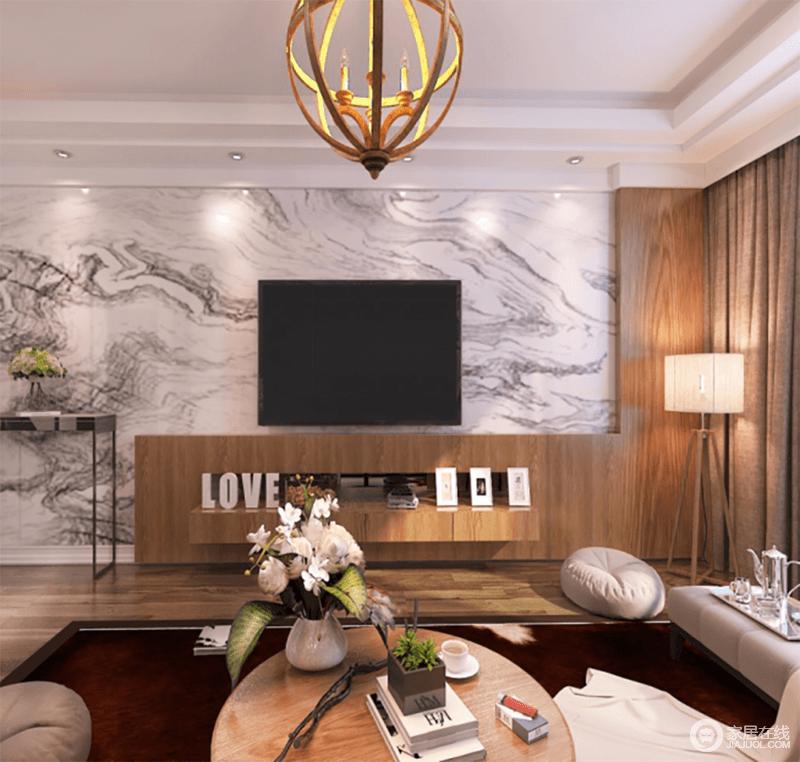 客厅的背景墙以灰白色大理石做装饰,赋予空间天然的云雾缥缈意境;原木电视柜与木质落地灯组合出朴质,无形中渲染了温和。