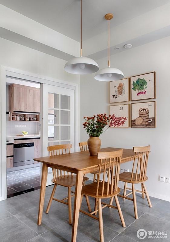 餐厅与厨房通过结构区分空间,白色格栅门不影响调性,空间分区明显,功能性强;灰色地面、白色墙面搭配原木家具,而挂画与吊灯与之配合,点缀出浓浓的北欧气息。