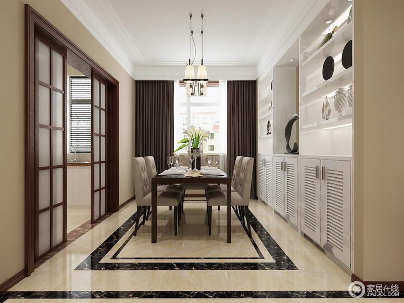 餐厅结构方正,整体空间以驼色漆和地砖奠定沉稳,地面黑色砖线的几何造型,解除了平淡;定制得白色橱柜解决了储物的需求,而推拉门将厨房与之区分,不影响空间的规整;现代家具和古典风的餐椅组合,颇显轻奢,而褐色窗帘的垂感,让整个空间愈加大气。
