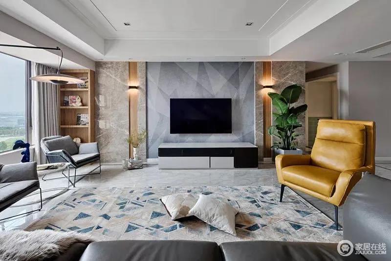 浅灰色的地面虽然略显冷冽,地面铺设了蓝色小三角图案的地毯,一把明黄色单人扶手椅与之形成色彩上的对比,呈现出一种简约优雅的氛围。