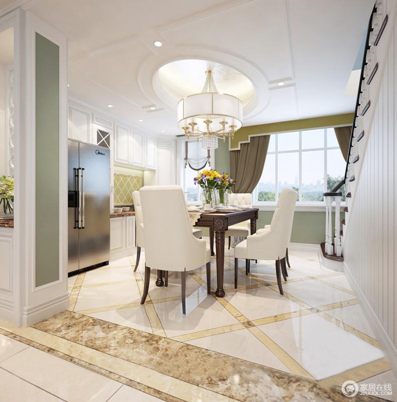 餐厅以建筑结构自然分区,开放式的设计却让空间具有关联性,餐厨一体设计更是将现代生活方式表现得淋漓尽致;米色地砖因为咖色砖线做装饰,铺贴出了菱形动感,美式现代餐椅组合给予生活足够的温情,让用餐便是一种放松和享受。