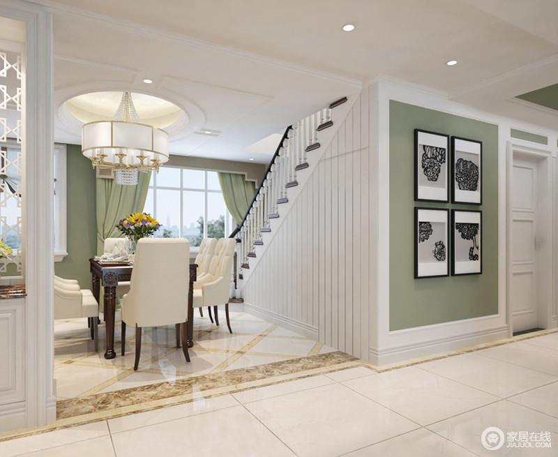 走廊以米色地砖来铺贴地面,与褐黄色过门石简单勾勒着层次,却让空间足够简洁;白色墙面的基础上粉刷了绿色漆,给空间一丝清爽,黑白画作点缀,让生活满含艺术气息,足以隽意。