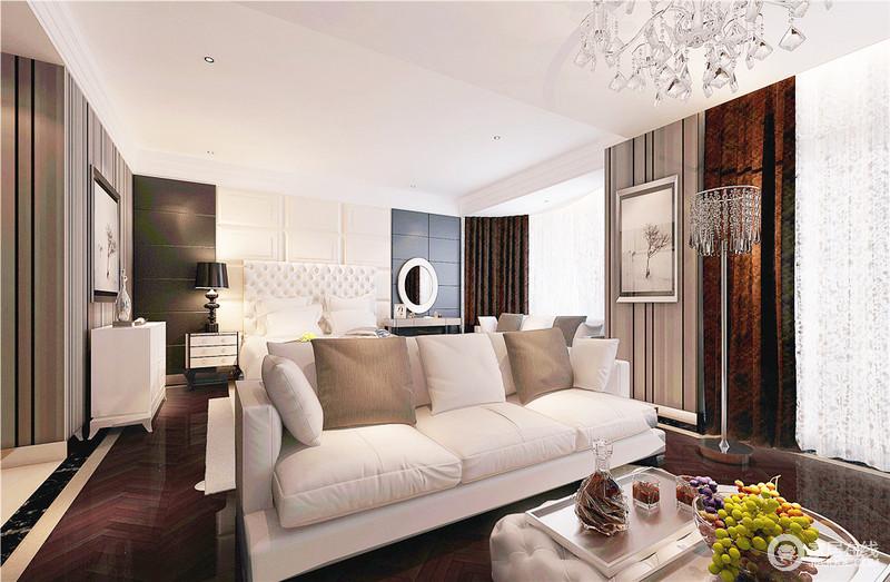 卧室并没有做得太过简单,黑白几何背景墙的时尚,水晶灯的璀璨和新古典边柜的轻奢,让生活足够考究和精致;休息区与睡眠区以动线分区,也以色彩来构建层次,器物之间,诠释着舒适、得体和温馨的生活。