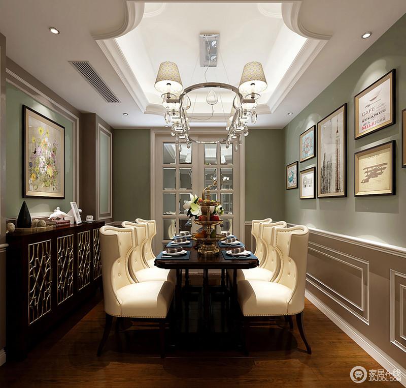 餐厅经典的美式线条为空间吊顶勾勒结构之美,搭配别致地吊灯和曲线感的铆钉餐椅,营造了轻奢的氛围;在清新和快的氛围下,美式实木餐桌和边柜的考究和精致因为画作、摆件,张扬着生活的品质。