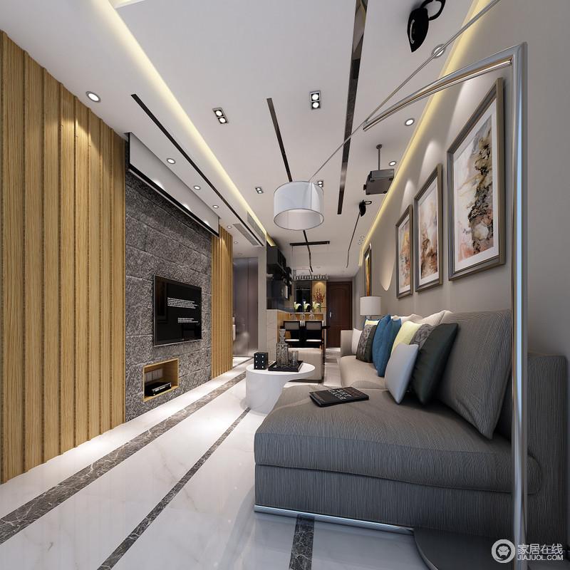 客厅现代感浓厚,灰色系壁纸与大理石组合,奠定了空间的沉浸,原木楞装饰在背景墙两侧,赋予空间暖意;黑白条纹组合的地砖搭配现代简约的家具和画作,造就文艺、冷静的生活氛围。