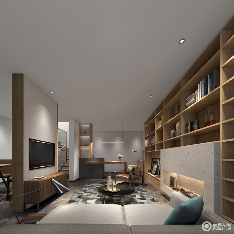 娱乐室的设计好似一个隐居得空间,正面背景墙做成了几何置物柜,让空间具有几何立体美学;实木家具搭配中性色的软装,渲染了沉浸和安谧,独立的学习区更满足主人练字、读书的喜好,十分安适。