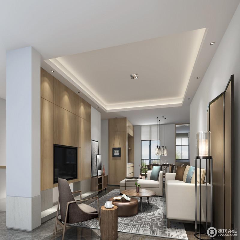 客厅现代简洁之中融入东方文化,屏风、博古架赋予生活底蕴,在灰色地面的基础上铺贴了个性的地毯,与米白色沙发、实木桌几塑造了够现代、精致的生活氛围,给人平静。