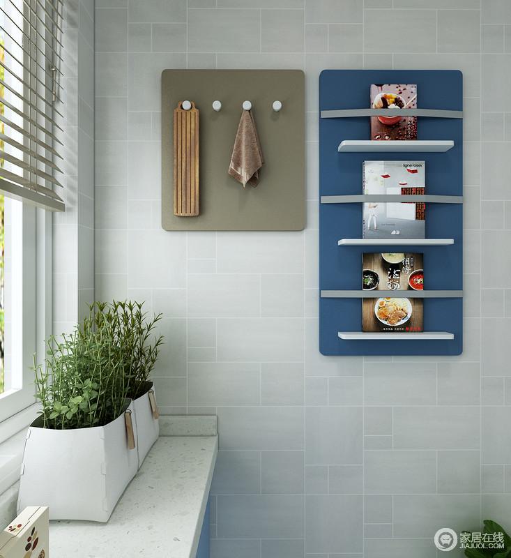 墙面空间还可以通过挂件来放置书籍资料和一些其他厨房用品。这样不仅可以方便使用,让空间变得整洁美观。