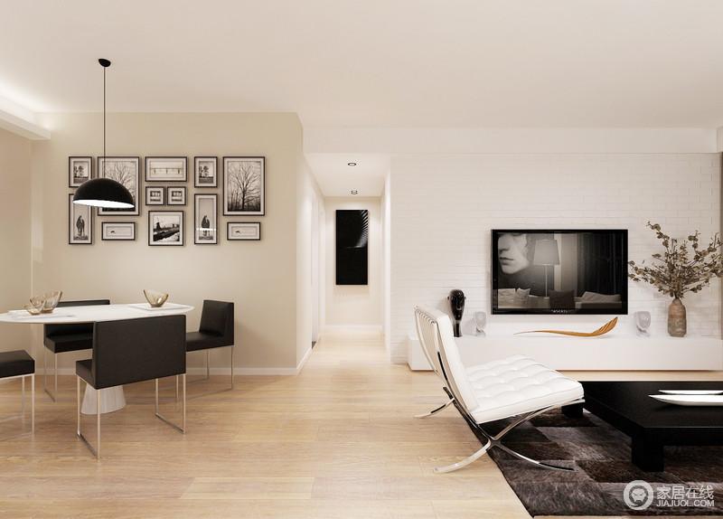 客餐厅开放式设计增加了生活的互动性,原木地板搭配米色墙面,造就温和;整个空间的家具以黑白色为搭配,让空间干练而现代。