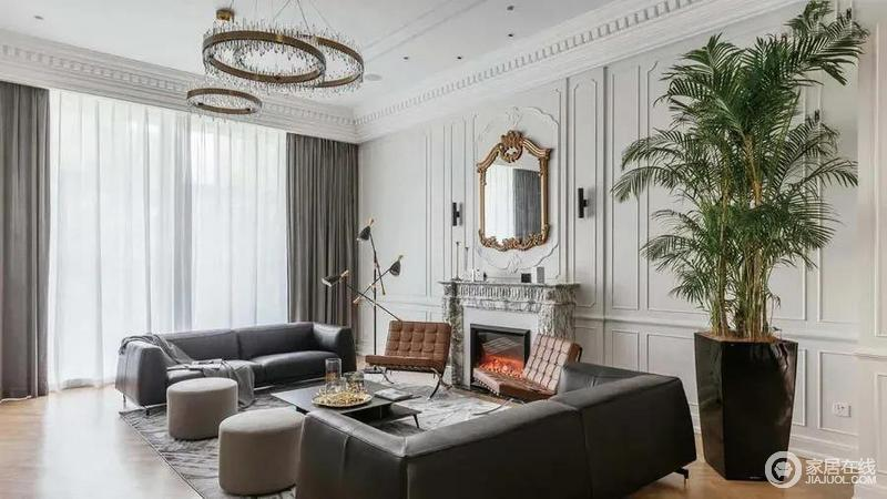 客厅取消了常规的沙发对电视的布置,采取会客式的布置,两张沙发对向摆放,两侧背景墙分别是电视墙与壁炉造型,使得生活空间更加优雅舒适。