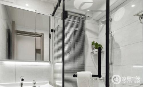 卫生间由于布局的改动用钻石型的淋浴房来解决干湿分离,屋主从实用角度出发,选的整体式的洗手盆镜柜和洗手台都是TOTO的,镜柜上下也留有灯带,作为辅助的照明相对舒适。
