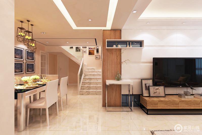 整个客餐厅以动线作和电视墙结构作了简单的分区,却以互动性的设计凸显空间感;浅驼色地砖搭配原木框颇显温和,楼梯白色大理石砖与墙面上的黑色画作以对比,搭配现代餐桌椅,令空间够现代。