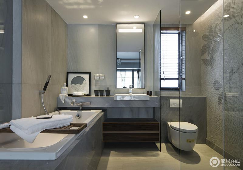 卫生间以灰色水泥质感的地砖来铺贴立面,搭配直线感的盥洗台,足显现代利落和大气;淋浴区与泡浴区做了区分,也解决了干湿的问题,而马赛克小砖的装饰,满载质感,让主人生活得更有品质。
