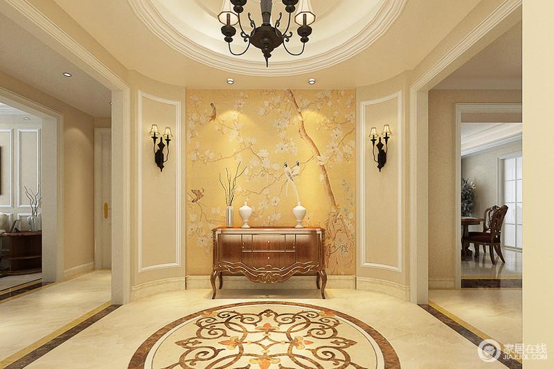 门厅因为结构显得较为方圆,椭圆形的吊顶搭配复古灯具,足显欧式美学;黄色花鸟图的立面让整个玄关明艳大气,搭配欧式拼花地面和边柜、灯饰,调和出家的华丽。