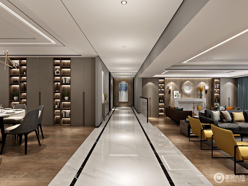 走廊将客厅和餐厅做了区分,两个空间以原木地板为材料,借驼色墙面来营造层次,温馨之中更有底蕴;灰色走廊因为黑色砖线的点缀更显现代,精致中只求简单。