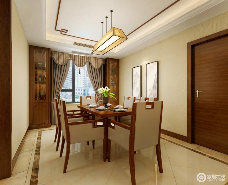 餐厅布置的很简洁,墙面上除了装饰的两幅挂画外,便是酒柜结合飘窗;木色的玻璃门酒柜搭配烟灰色罗马帘,沉稳且端正;餐桌椅造型同样方正朴实,餐椅上的皮质色调与墙面、地面相近,在米色调的诠释下,温馨舒适。
