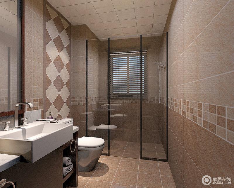 卫生间使用棕黄与驼色铺陈出空间的墙砖、地面,玻璃材质分隔出干湿区;拼接的小花砖作为腰线点缀出活泼感,而大块拼接方砖则作为马桶背景墙,以示不同。