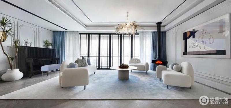 客厅在空间布局十分宽阔,白色法式线条的精巧与木色地板冷淡的底色渲染出强烈的空间感和立体感,蓝色窗帘盒扎染的地毯赋予空间更为灵气;整个空间通透大气。划分出适合现代生活方式的功能区,大气别致。