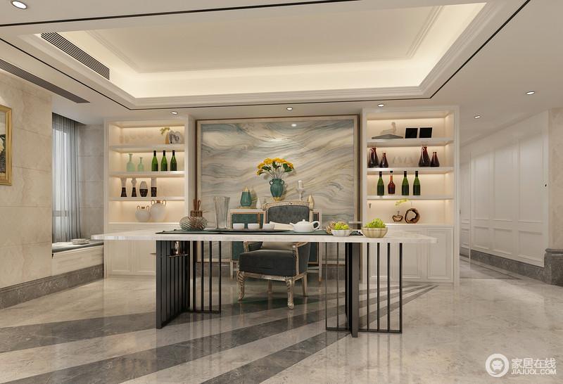 茶室布置的简约轻奢,对称的白色酒柜中央,整块的大理石纹背景与客厅电视墙遥相呼应,制造空间上的统一感;茶桌采用大理石拼接铁艺金属,硬朗的线条则与地板制造视觉跃动层次。