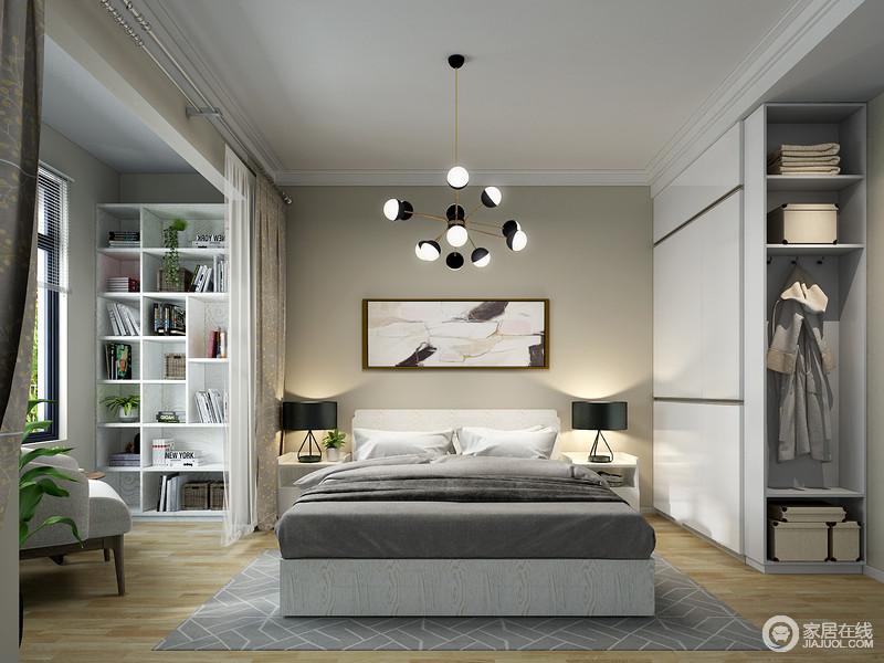 卧室以白色和浅灰色为主,结构和功能层次十分分明,而白色定制衣柜与阳台处的几何书柜,让空间具有收纳哲学;散落样式的吊灯裹挟着现代工业设计之美,与床头柜的黑色台灯,给予空间黑色庄重,与灰白色床品成就生活的简单、舒适。