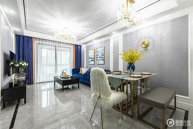 餐厅和客厅连通,阳台采光通透,一体式设计婉约流畅,灰白色的搭配,让空间更为大气,也加强了互动性;金属底座的餐桌搭配现代餐椅和毛绒椅面的单椅,混搭出轻奢与可爱风。