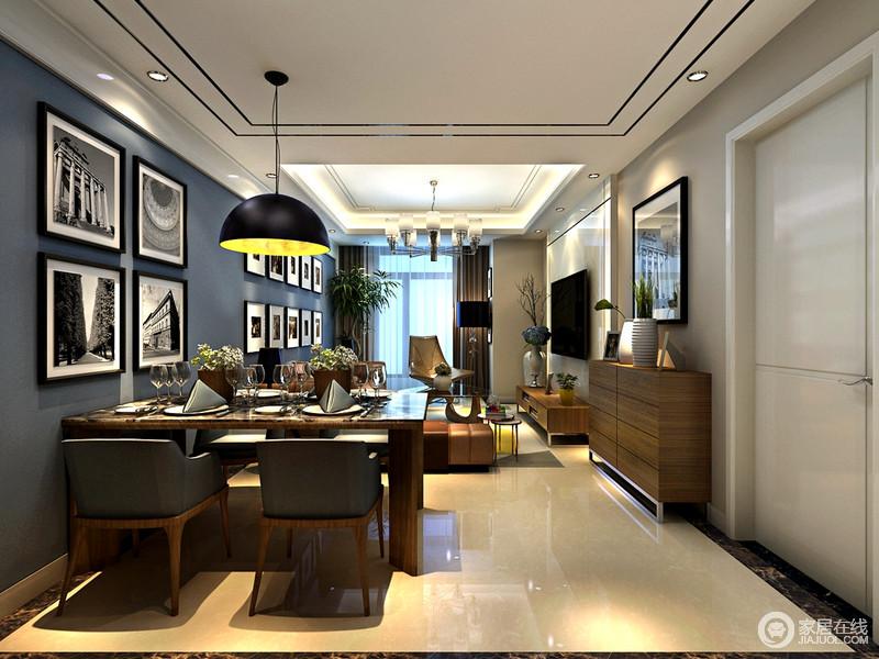 深灰蓝墙面深邃的作为背景烘托,从客厅到餐厅,使整个空间沉静如水;四副黑白画作艺术渲染餐厅氛围,厚重理石实木餐桌,延续墙面内敛格调,配灰褐拼接材质餐椅,在硕大黑色吊灯独束光影下,一派成熟浪漫情调。