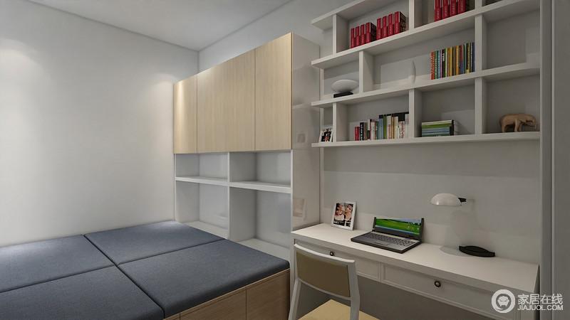 次卧空间也不大,设计师用榻榻米解决空间问题;同样组合式的衣柜和书桌、书架,放大了空间的实用性。